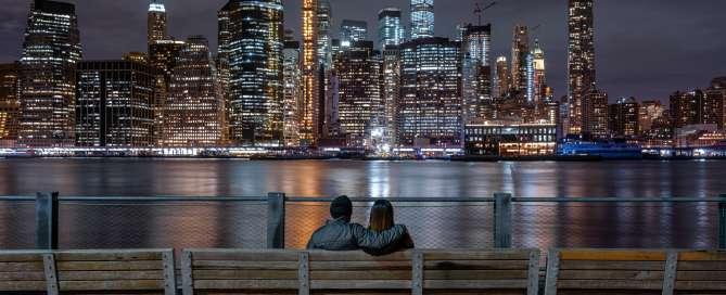 Couple sitting watching NYC night skyline
