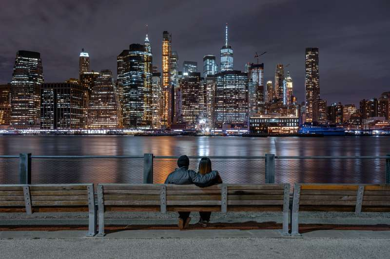 Couple sitting watching NYC night skyline